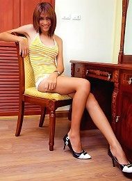 Long-legged ladyboy Kae smilingly stripping naked