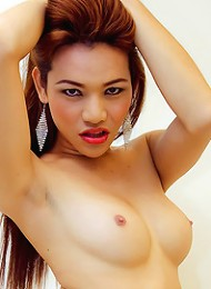 Ladyboy in red lingerie and fishnets getting horny