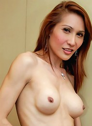 pretty Asian tranny wanks her manly cock
