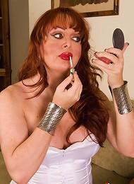 Busty seductive transsexual redhead posing