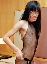 Big Bangkok ladyboy wanks in her bodystocking