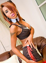 Sultry ladyboy in red boots ready for hard work