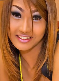 Ladyboy Fish in yellow bikini under her silky suit