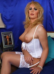 Brtish shemale shows off in a sexy white corset
