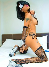 Submissive tranny tied up and blindfolded on a bed